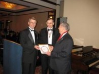 Arthur Allan Bártfay receives the Árpád Academy Award from the Árpad Academy Secretary General Lél Somogyi (left) and Dr. John Nádas, President of the Hungarian Aosssciation (center) in 2012.